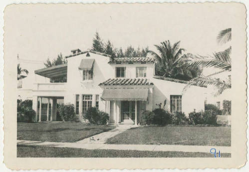 Photo of two story Mediterranean style home in Miami Beach, FL.